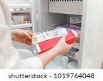 the doctor takes out medicine... | Shutterstock . vector #1019764048