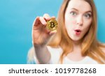 woman holding a physical...   Shutterstock . vector #1019778268