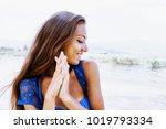 portrait of a beautiful happy... | Shutterstock . vector #1019793334