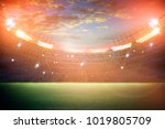 stadium in lights and flashes  | Shutterstock . vector #1019805709