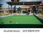 retired seniors playing bocce... | Shutterstock . vector #1019809294