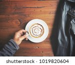 latte art coffee with hand and... | Shutterstock . vector #1019820604