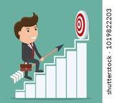 businessman holding arrow walks ...   Shutterstock .eps vector #1019822203