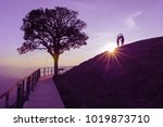 couple silhouette on hill and... | Shutterstock . vector #1019873710