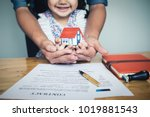 hands holding small house after ... | Shutterstock . vector #1019881543