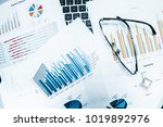 glasses with business graphs... | Shutterstock . vector #1019892976