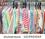 many clothes hanging on a... | Shutterstock . vector #1019903569