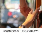 hand holding safety straps ... | Shutterstock . vector #1019908594