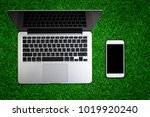 top view of laptop on green... | Shutterstock . vector #1019920240