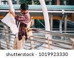 asian traveler man is standing...   Shutterstock . vector #1019923330