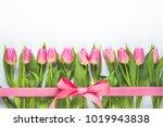 top view of pink tulips... | Shutterstock . vector #1019943838