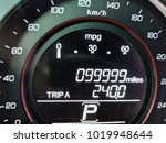 Small photo of 1 Mile before car odometer turns to 100,000 miles