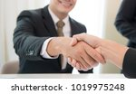 lawyers handshake attorneys... | Shutterstock . vector #1019975248