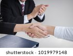 greeting new colleagues ... | Shutterstock . vector #1019979148