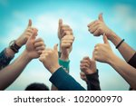 college students with thumbs up | Shutterstock . vector #102000970