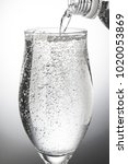 pour carbonated water into a... | Shutterstock . vector #1020053869