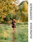 pregnant woman walking in the... | Shutterstock . vector #1020056620
