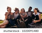 group of friends sitting... | Shutterstock . vector #1020091480