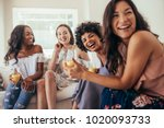 diverse group of female friends ... | Shutterstock . vector #1020093733