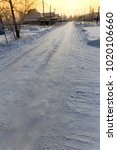 road in the snow in the village | Shutterstock . vector #1020106660