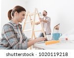 young smiling couple renovating ... | Shutterstock . vector #1020119218