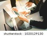 business women looking at... | Shutterstock . vector #1020129130