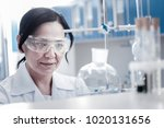 monitoring the process. mature... | Shutterstock . vector #1020131656
