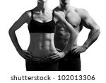 Small photo of Bodybuilding. Strong man and a woman posing. Isolated on white background