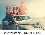 group of happy friends in a car ... | Shutterstock . vector #1020141868