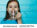 beautiful little girl drinks... | Shutterstock . vector #1020150754