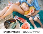 Mother With Son Have Picnic On...