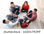 group of young people sitting... | Shutterstock . vector #1020179299