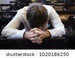 caucasian man praying in church.... | Shutterstock . vector #1020186250