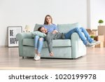 young couple resting on sofa... | Shutterstock . vector #1020199978