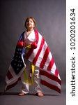 girl karate yellow belt with us ... | Shutterstock . vector #1020201634