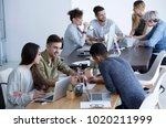 cooperation between coworkers... | Shutterstock . vector #1020211999