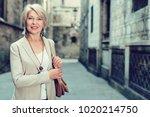 elegant mature woman is posing... | Shutterstock . vector #1020214750
