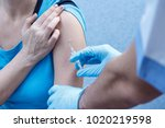 hands of doctor in blue gloves... | Shutterstock . vector #1020219598