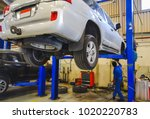suv car lifted in service... | Shutterstock . vector #1020220783