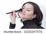 smiling young woman with brush... | Shutterstock . vector #1020247576