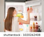 woman choosing food in... | Shutterstock . vector #1020262408
