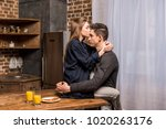 girlfriend sitting on table in... | Shutterstock . vector #1020263176