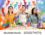 teenagers with party horns and... | Shutterstock . vector #1020274570