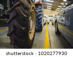 Tractor And Cars Parked In The...