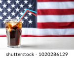glass of cold cola on table... | Shutterstock . vector #1020286129