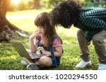 children playing tablet in the... | Shutterstock . vector #1020294550