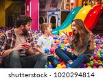 young happy family with their... | Shutterstock . vector #1020294814