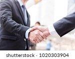 business people shaking hands ... | Shutterstock . vector #1020303904