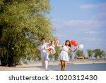 mom  dad and daughter walking...   Shutterstock . vector #1020312430