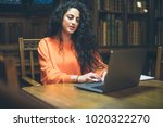 woman using computer in old... | Shutterstock . vector #1020322270